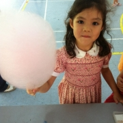 Posing for a shot with the candy floss!